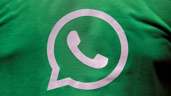 A logo of WhatsApp is pictured on a T-shirt worn by a WhatsApp-Reliance Jio representative during a drive by the two companies to educate users - Sputnik International