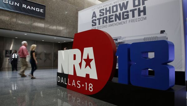 People walk by NRA convention signage in the Kay Bailey Hutchison Convention Center in Dallas, Thursday, May 3, 2018. The convention is scheduled to go through Sunday. - Sputnik International