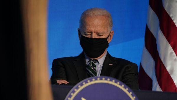 President-elect Joe Biden listens during an event at The Queen theater, Saturday, Jan. 16, 2021, in Wilmington, Del - Sputnik International