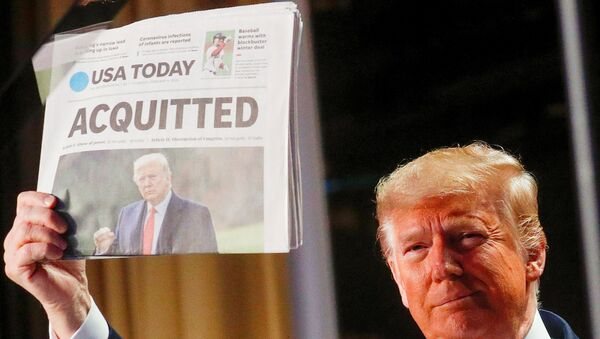 U.S. President Donald Trump holds up a copy of USA Today's front page showing news of his acquittal in his Senate impeachment trial, as he arrives to address the National Prayer Breakfast in Washington, U.S., February 6, 2020 - Sputnik International