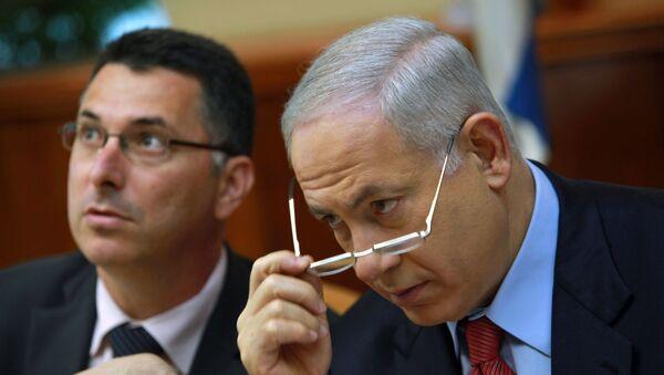 Israeli Prime Minister Benjamin Netanyahu, right, and Education Minister Gideon Saar, attend the weekly cabinet meeting in Jerusalem, Sunday, Oct. 18, 2009. - Sputnik International