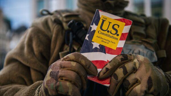 WASHINGTON, DC - JANUARY: 17 National Guard Master Sergeant George Roachs holds up a pamphlet of the U.S. Constitution on January 17, 2021 in Washington, DC.  - Sputnik International
