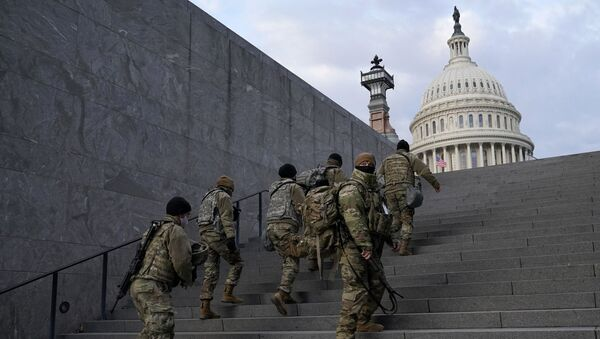 National Guard members take a staircase toward the U.S. Capitol building before a rehearsal for President-elect Joe Biden's Presidential Inauguration in Washington, Monday, Jan. 18, 2021 - Sputnik International