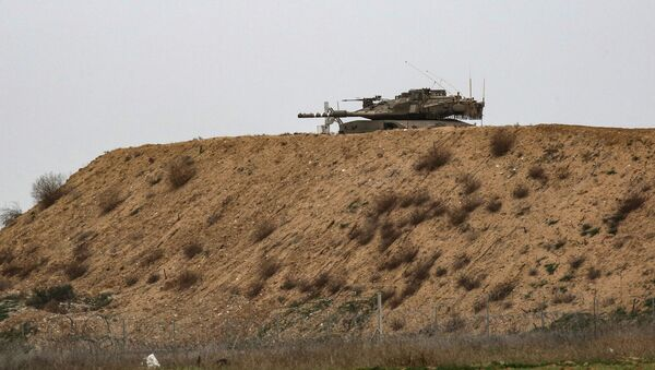 An Israeli tank is pictured on Israel's border with Gaza, opposite the Palestinilan city of Khan Yunis in the southern Gaza Strip, on January 13, 2021. - Sputnik International