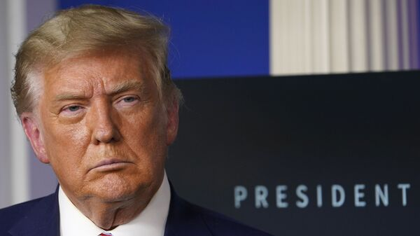 In this Friday, Nov. 20, 2020, file photo, President Donald Trump listens during an event in the briefing room of the White House in Washington. - Sputnik International