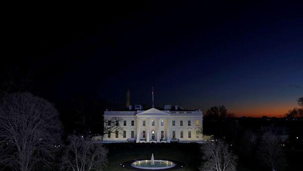 The sun sets near the White House on the final night of Donald Trump's presidency, ahead of U.S. President-elect Joe Biden's inauguration, in Washington, U.S., January 19, 2021 - Sputnik International
