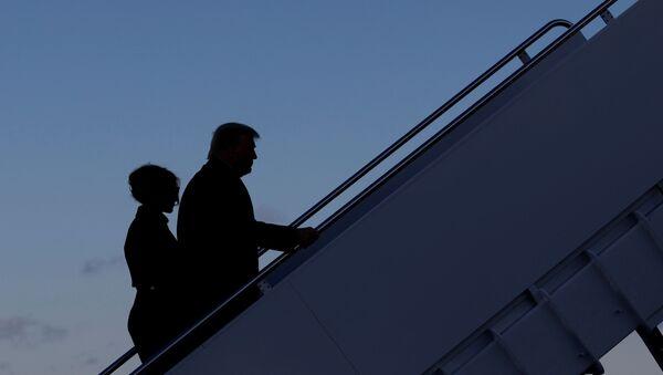 U.S. President Donald Trump departs next to first lady Melania Trump from the Joint Base Andrews, Maryland, U.S., January 20, 2021. - Sputnik International