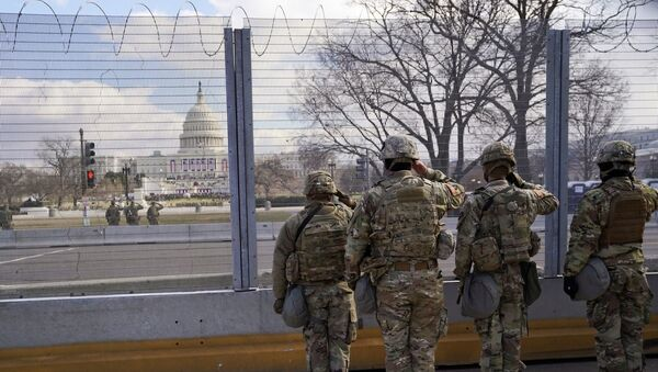 National Guard members salute in front of the U.S. Capitol building during the inauguration of President-elect Joe Biden in Washington, U.S., January 20, 2021.  - Sputnik International