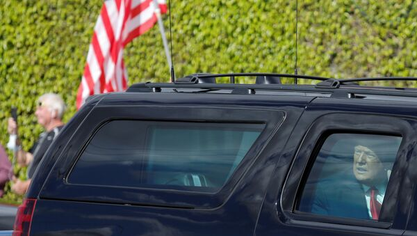 U.S. President Donald Trump reacts in a car as he drives past supporters in West Palm Beach, Florida, U.S., January 20, 2021.  - Sputnik International