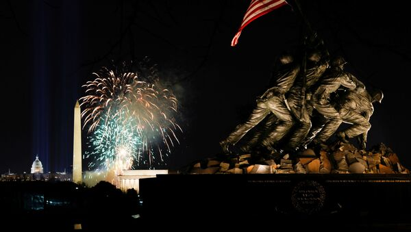 Fireworks are seen over the National Mall during the Celebrating America event at the Lincoln Memorial in Washington, after the inauguration of Joe Biden as the 46th President of the United States, in U.S., January 20, 2021 - Sputnik International