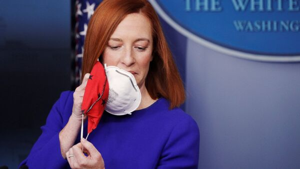 White House Press Secretary Jen Psaki removes her face mask before speaking in the James S Brady Press Briefing Room at the White House, after the inauguration of Joe Biden as the 46th President of the United States, U.S., January 20, 2021 - Sputnik International