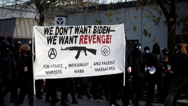 Activists take part in a protest after the inauguration of U.S. President Joe Biden, in Portland, Oregon, U.S. January 20, 2021. - Sputnik International