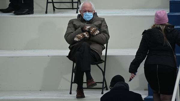 Former presidential candidate, Senator Bernie Sanders (D-Vermont) sits in the bleachers on Capitol Hill before Joe Biden is sworn in as the 46th US President - Sputnik International