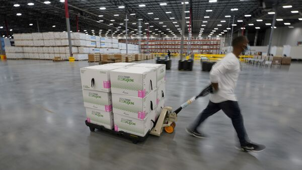 FILE PHOTO: Boxes containing the Moderna COVID-19 vaccine are prepared to be shipped at the McKesson distribution center in Olive Branch, Mississippi, U.S. December 20, 2020 - Sputnik International