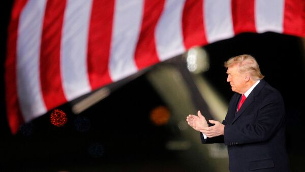 U.S. President Donald Trump applauds as he campaigns with  Republican U.S. Senator Kelly Loeffler  on the eve of Georgia's run-off election in Dalton, Georgia, U.S., January 4, 2021 - Sputnik International