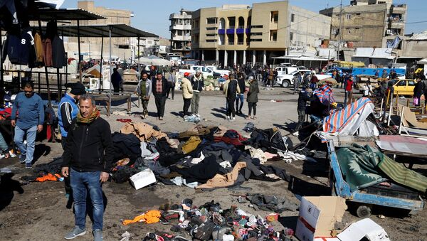 The site of a twin suicide bombing attack in a central market is seen in Baghdad, Iraq January 21, 2021. - Sputnik International