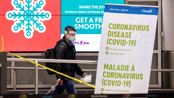 A man walks through terminal 3, amid a spike in coronavirus disease (COVID-19) cases, at Pearson airport near Toronto, Ontario, Canada December 30, 2020.  - Sputnik International