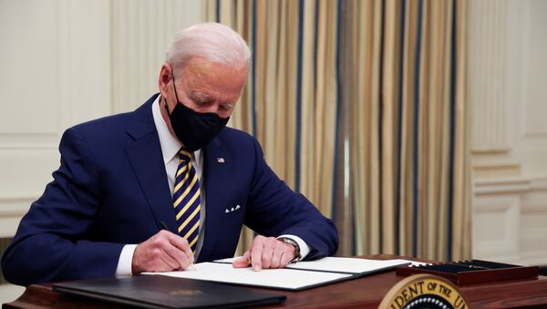 U.S. President Joe Biden and signs an executive order after speaking about his administration's plans to respond to the economic crisis during a coronavirus disease (COVID-19) response event in the State Dining Room at the White House in Washington, U.S., January 22, 2021. - Sputnik International
