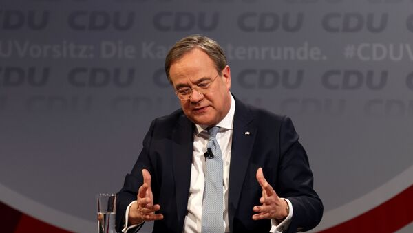 Armin Laschet speaks as he takes part in a discussion with other candidates for the chairmanship of Germany's Christian Democratic Union (CDU) party Friedrich Merz and Norbert Roettgen, at the party's headquarters in Berlin, Germany, January 8, 2021. - Sputnik International