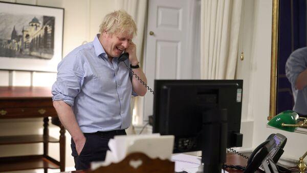 British Prime Minister Boris Johnson speaks to U.S. President Joe Biden from London, Britain in this social media image obtained on January 23, 2021. - Sputnik International