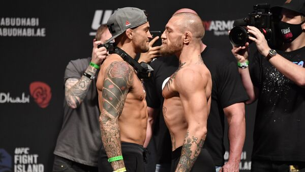 Dustin Poirier and Conor McGregor of Ireland face off during the UFC 257 weigh-in at Etihad Arena on UFC Fight Island on January 22, 2021 in Abu Dhabi, United Arab Emirates.  - Sputnik International