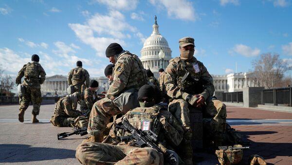 National Guard troops gather in front of the U.S. Capitol one day ahead of President-elect Joe Biden's Inauguration in Washington, U.S. January 19, 2021. - Sputnik International
