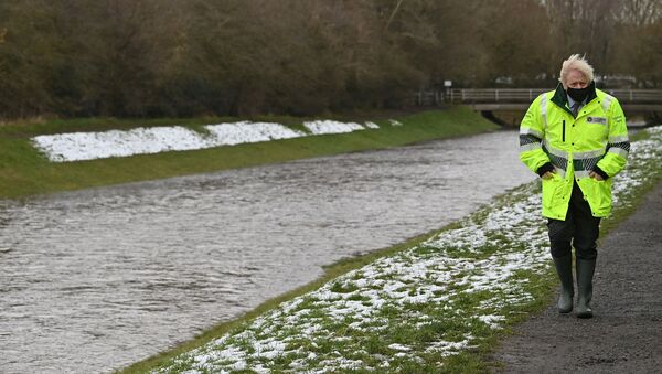 Britain's Prime Minister Boris Johnson reacts during his visit to a storm basin near the River Mersey in  Didsbury, Manchester, as Storm Christoph brings heavy rains and flooding across the country, Britain January 21, 2021 - Sputnik International