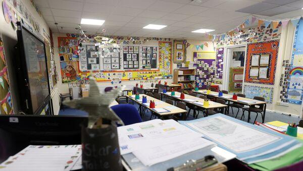 An empty classroom is seen at Westlands Primary School, amid the coronavirus disease (COVID-19) outbreak, in Newcastle-under-Lyme, Staffordshire, Britain, January 4, 2021.  - Sputnik International