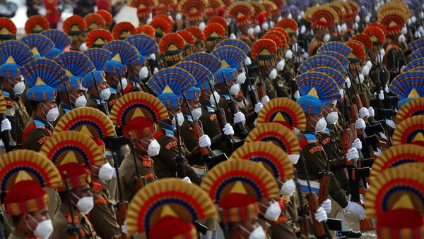 Indian security forces personnel wearing protective face masks take part in a full dress rehearsal for the Republic Day parade in Srinagar, 24 January 2021.  - Sputnik International