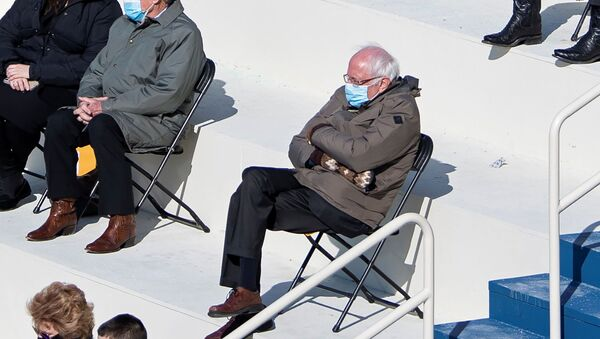 US Senator Bernie Sanders sits socially distanced as he attends the Presidential Inauguration of Joe Biden on the West Front of the US Capitol in Washington, DC, 20 January 2021.  - Sputnik International