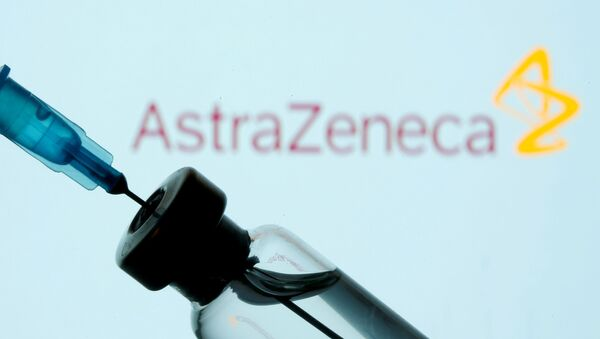 FILE PHOTO: A vial and syringe are seen in front of a displayed AstraZeneca logo in this illustration taken January 11, 2021 - Sputnik International