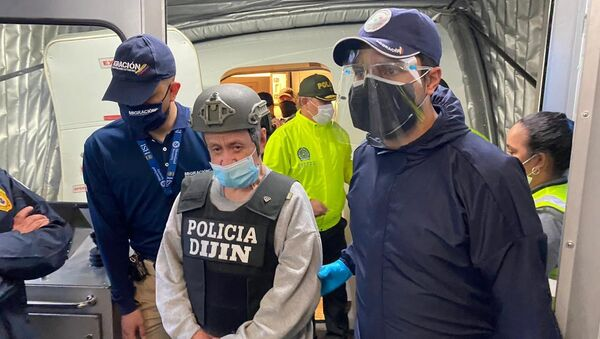 In this photo released by the Colombian Migration Press Office, ex-paramilitary commander Hernan Giraldo Serna, center, is escorted upon arrival at the El Dorado airport after being deported from the U.S. to Bogota, Colombia, Monday, Jan. 25, 2021. Giraldo, 74, was deported from the U.S. and immediately taken into custody by authorities in Colombia, where he is expected to serve time for crimes against humanity, including torture, displacement, sexual slavery and kidnapping, as well as drug trafficking - Sputnik International