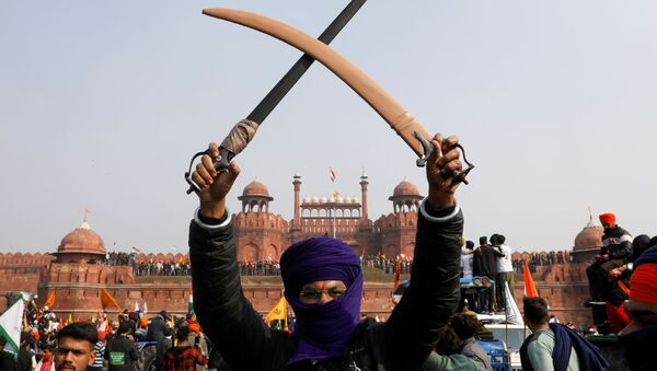 A farmer holds a sword during a protest against farm laws introduced by the government, at the historic Red Fort in Delhi, India, 26 January 2021 - Sputnik International