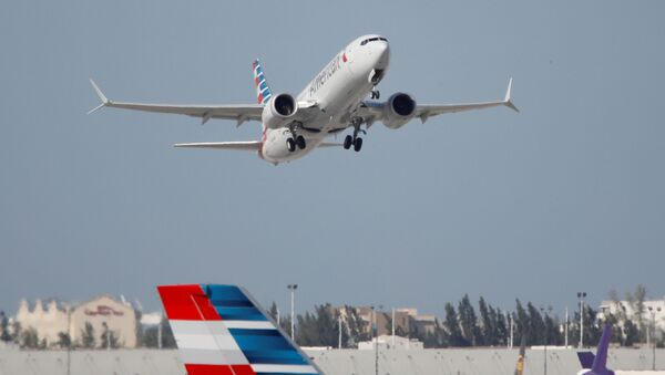 American Airlines flight 718, the first U.S. Boeing 737 MAX commercial flight since regulators lifted a 20-month grounding in November, takes off from Miami, Florida, U.S. December 29, 2020 - Sputnik International