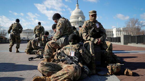National Guard troops gather in front of the U.S. Capitol one day ahead of President-elect Joe Biden's Inauguration in Washington, U.S. January 19, 2021. REUTERS/Mike Segar/File Photo - Sputnik International