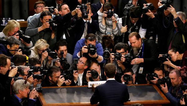Facebook CEO Mark Zuckerberg is surrounded by members of the media as he arrives to testify before a Senate Judiciary - Sputnik International