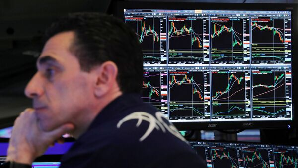 A trader at the New York Stock Exchange works as markets continue to react to the coronavirus disease (COVID-19) inside of the NYSE in New York, U.S., March 18, 2020 - Sputnik International