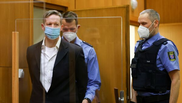 Main defendant Stephan Ernst arrives at the courtroom as he waits for the verdict in the case of the murder of Walter Luebcke, at the Higher Regional Court in Frankfurt, Germany, 28 January 2021 - Sputnik International