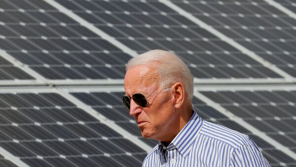 Democratic 2020 U.S. presidential candidate and former Vice President Joe Biden walks past solar panels while touring the Plymouth Area Renewable Energy Initiative in Plymouth, New Hampshire, U.S., June 4, 2019.   - Sputnik International