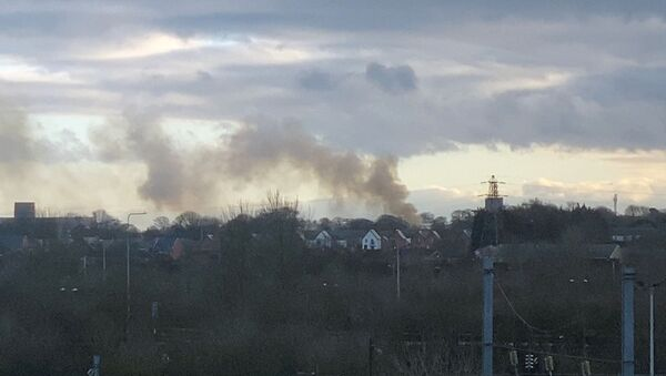 Smoke billows as fire breaks out at Napier Barracks, government housing for asylum seekers, in Folkestone, Britain January 29, 2021, in this still image obtained from social media video.  - Sputnik International