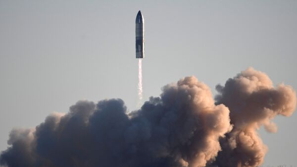 SpaceX launches its first super heavy-lift Starship SN8 rocket during a test from their facility in Boca Chica,Texas, U.S. December 9, 2020 - Sputnik International