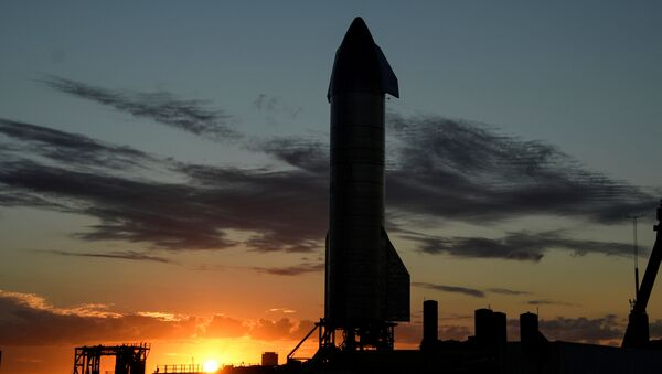 The sun sets as SpaceX prepares their super heavy-lift Starship SN8 rocket  for a test launch this week at the company's facilities in Boca Chica, Texas, US December 1, 2020 - Sputnik International