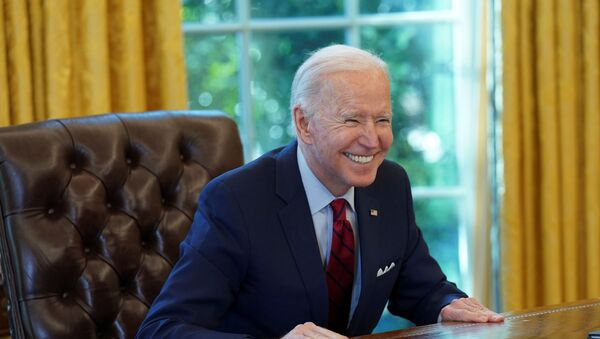 U.S. President Joe Biden smiles after signing executive orders strengthening access to affordable healthcare at the White House in Washington, U.S., January 28, 2021 - Sputnik International