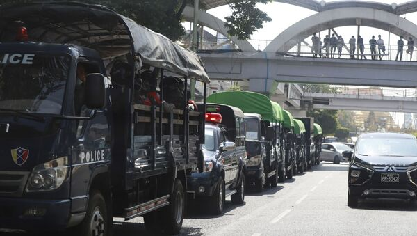 Policemen sit inside trucks parked on a road in the downtown area of Yangon, Myanmar - Sputnik International