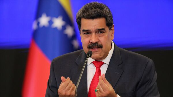 Venezuelan President Nicolas Maduro gestures as he speaks during a news conference following the ruling Socialist Party's victory in legislative elections that were boycotted by the opposition in Caracas, Venezuela December 8, 2020. - Sputnik International