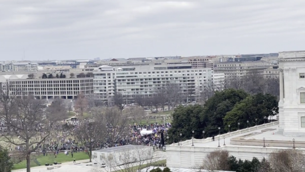 A view of the January 6 insurrection at the US Capitol from atop the Longworth House Office Building, as seen in a video posted to Parler by  Joel Valdez, an assistant to Rep. Matt Gaetz (R-FL) - Sputnik International