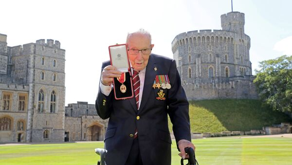 Captain Tom Moore poses after being awarded with the insignia of Knight Bachelor by Britain's Queen Elizabeth at Windsor Castle, in Windsor, Britain July 17, 2020. - Sputnik International