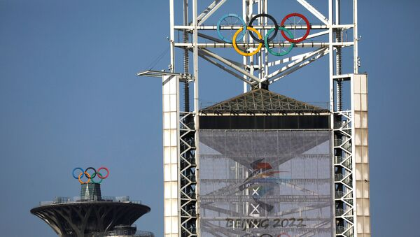 Olympic rings and a sign of 2022 Winter Olympic Games, are seen at the Beijing Olympic Green in Beijing, China, January 29, 2021. Picture taken January 29, 2021. - Sputnik International
