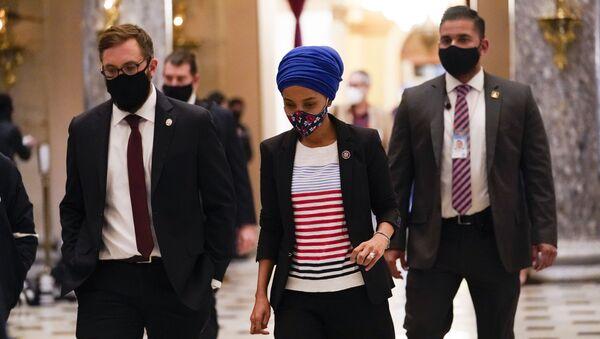Rep. Ilhan Omar, D-Minn., walks to the House chamber on Capitol Hill in Washington, Wednesday, Jan. 13, 2021. - Sputnik International