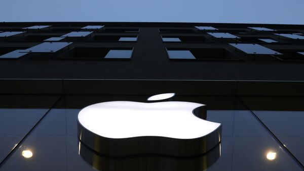 The logo of Apple is illuminated at a store in the city center in Munich, Germany, Wednesday, Dec. 16, 2020. - Sputnik International